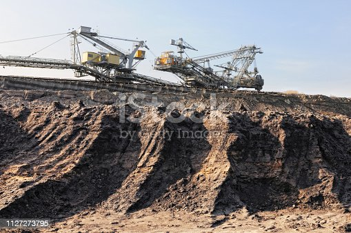 istock Coal mine with bucket wheel excavator. air pollution. 1127273795
