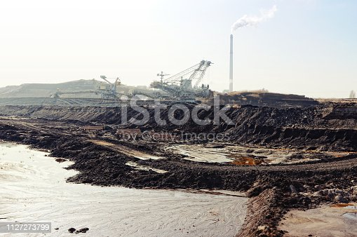 istock Coal mine with bucket wheel excavator. air pollution. 1127273799