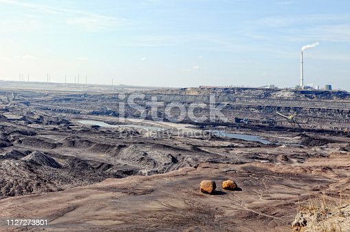 istock Coal mine with bucket wheel excavator. air pollution. 1127273801
