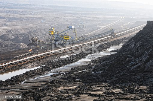 istock Coal mine with bucket wheel excavator. air pollution. 1127273803