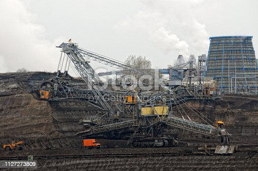 istock Coal mine with bucket wheel excavator. air pollution. 1127273809