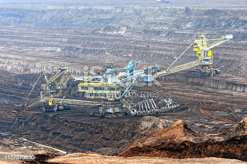 istock Coal mine with bucket wheel excavator. air pollution. 1127273830