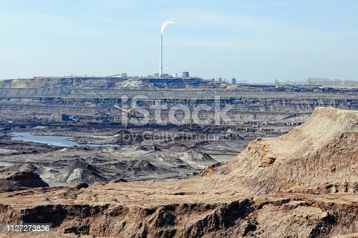 istock Coal mine with bucket wheel excavator. air pollution. 1127273836