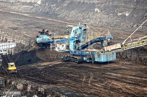 istock Coal mine with bucket wheel excavator. air pollution. 1127273852