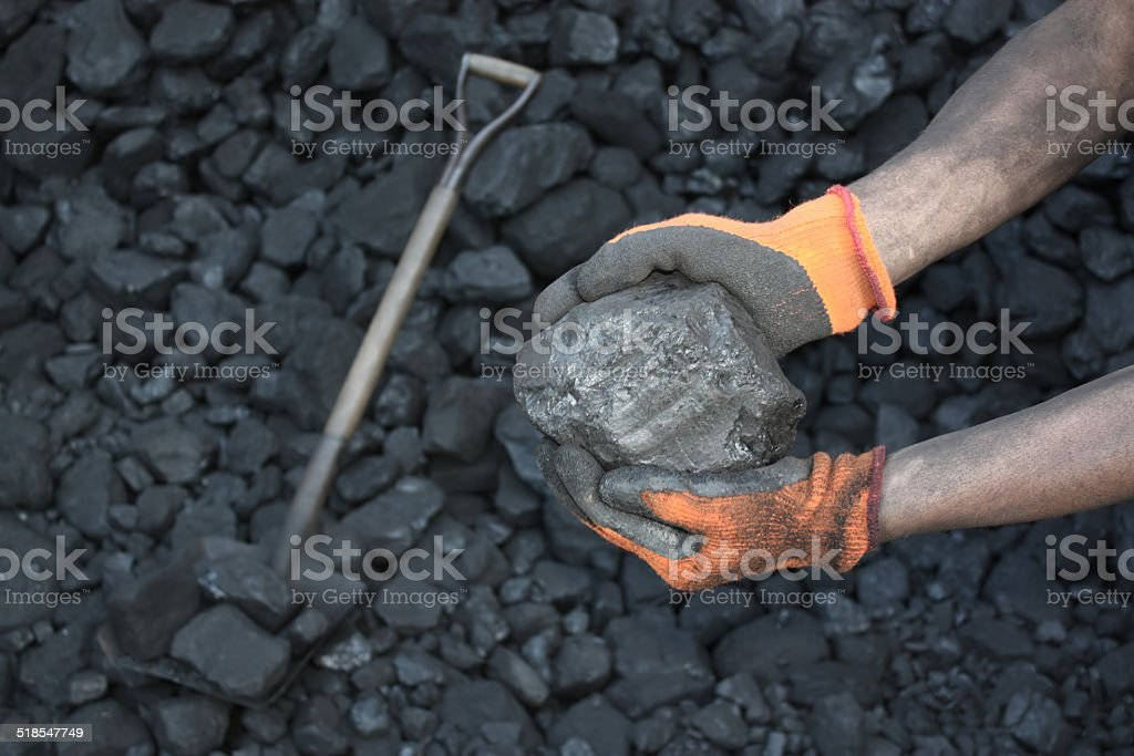 Coal miner showing stock photo