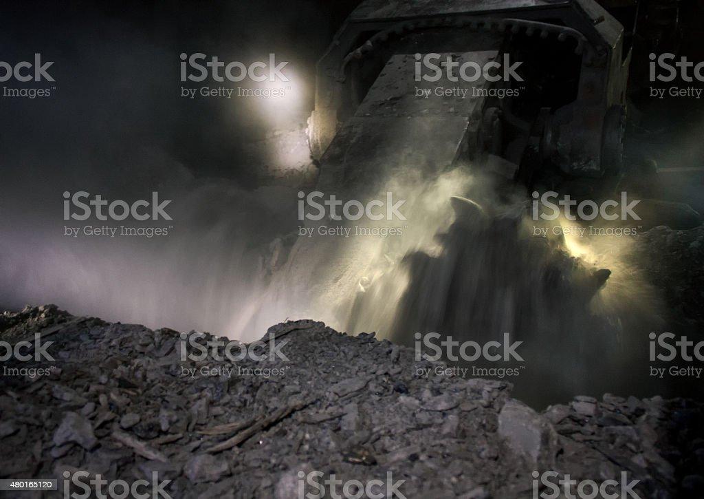 Coal mining machine during operation stock photo