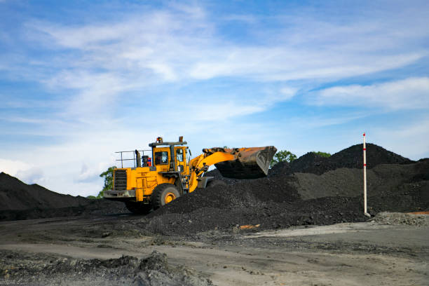 coal mining production at one of the open fields stock photo