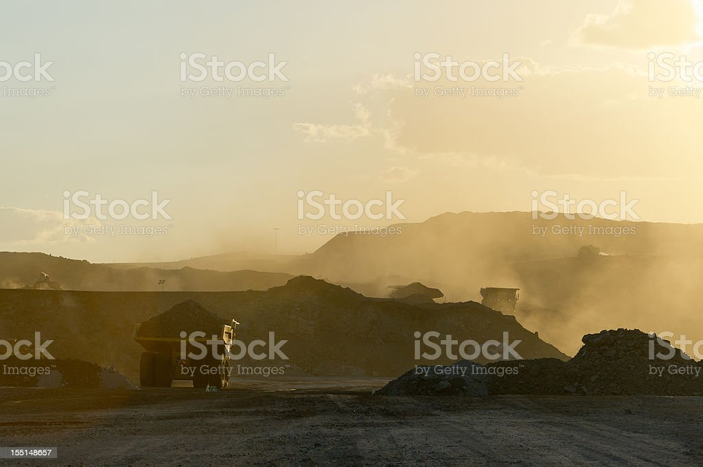 Coal mining truck hauling dirt on a hazy day stock photo