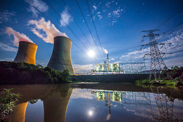 coal power plant at river - power in nature stock photos and pictures