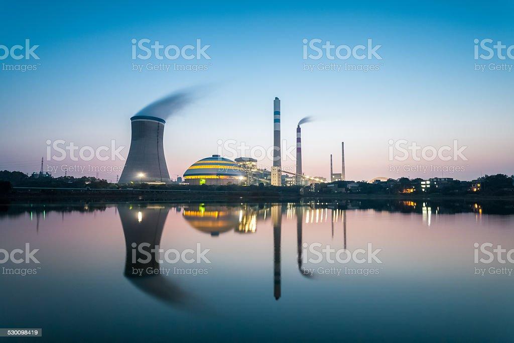 coal power plant in nightfall stock photo