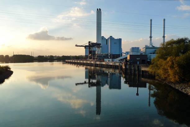 coal power plant r on the side of a canal, germany - cogeneration plant stock photos and pictures