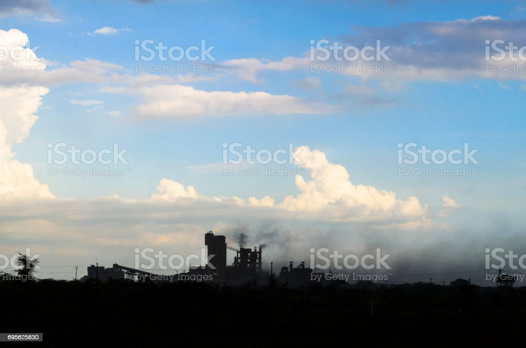 Coal power station and cement plant at night stock photo
