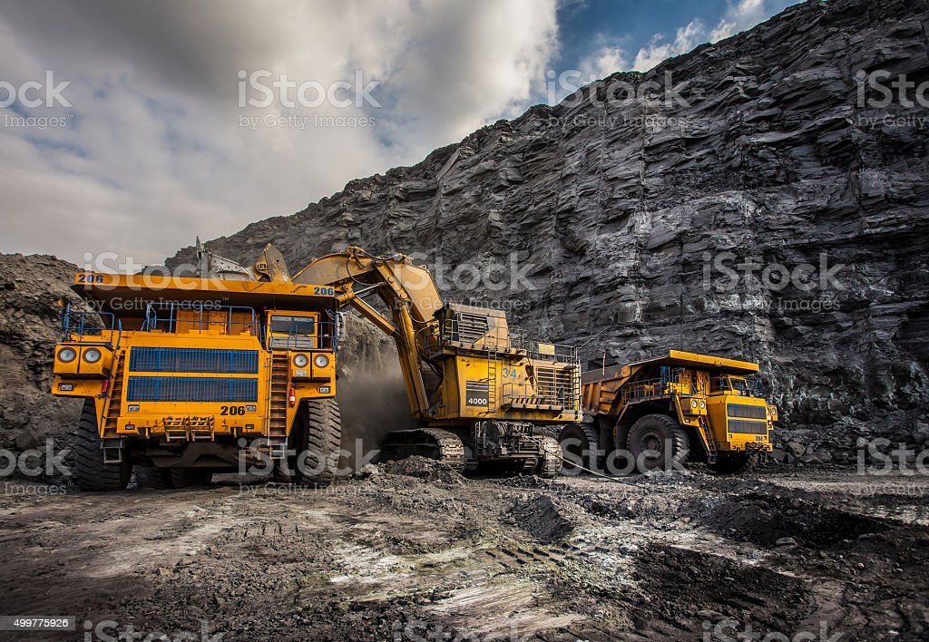 """Coal production at one of the open fields Coal production at one of the open fields in the south of Siberia. Dumpers """"BelAZ"""". September 2015.  Business Finance and Industry Stock Photo"""