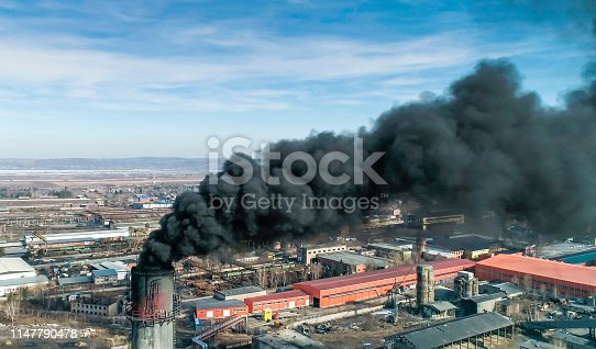 istock Coal-fired Smokestack Releasing Black Smoke into the air. 1147790478
