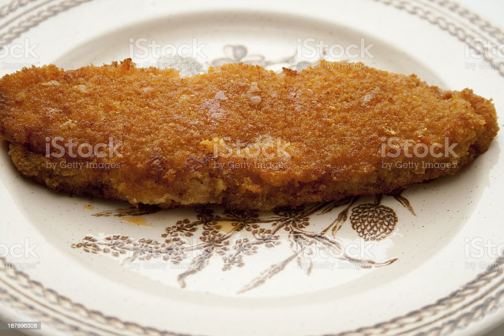 Coalfish fillet breads on plate stock photo