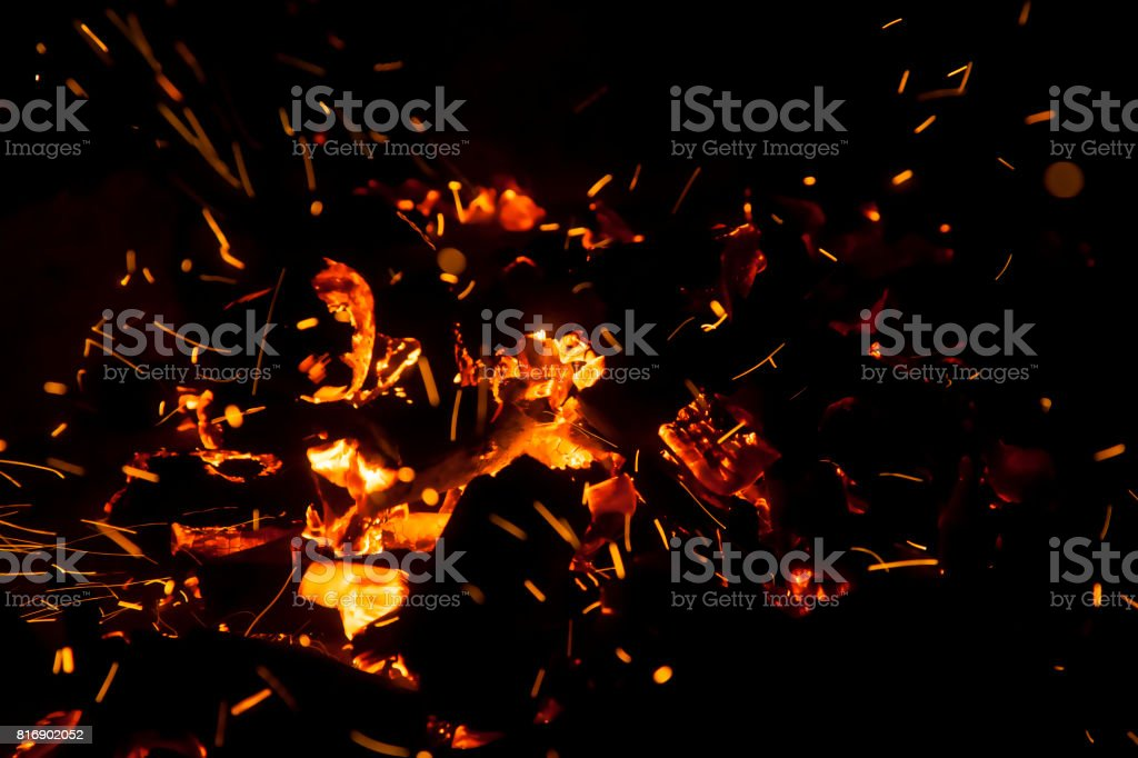 coals burning in a barbecue stock photo