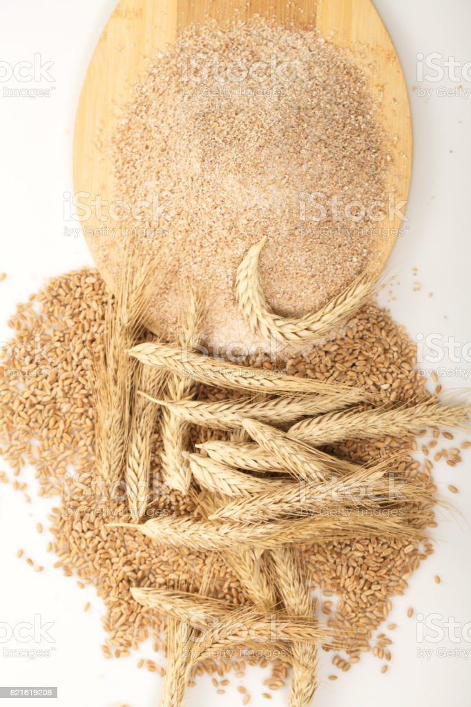 Coarse flour and wheat with spikelets stock photo