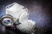 istock Coarse grained sea salt in a glass container 950380890