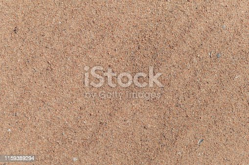 large fractions of yellow sand on the beach top view