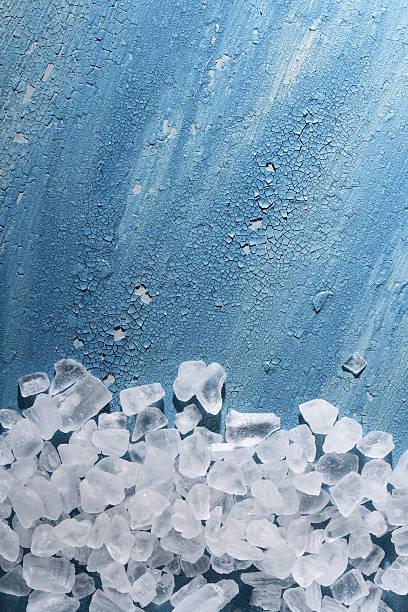 Coarse sea salt on old cracked painted background stock photo