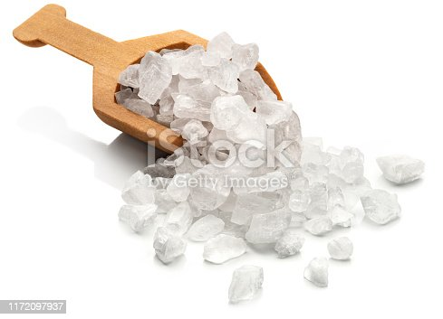 Coarse sea salt in a wooden scoop.  Isolated on a white background.