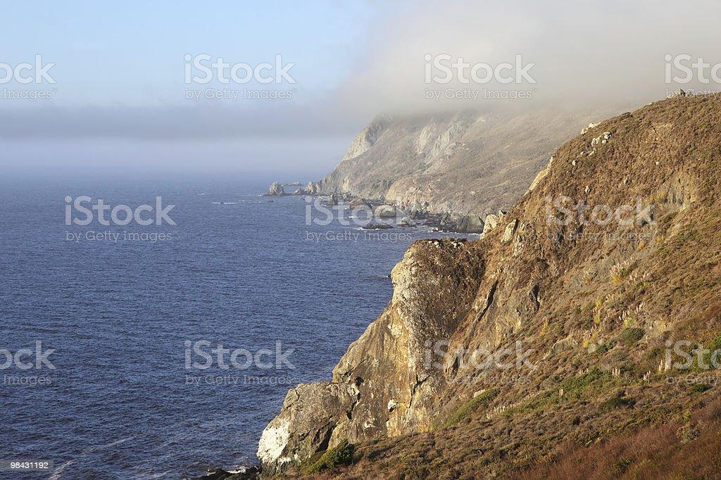 Coast and a morning fog royalty-free stock photo
