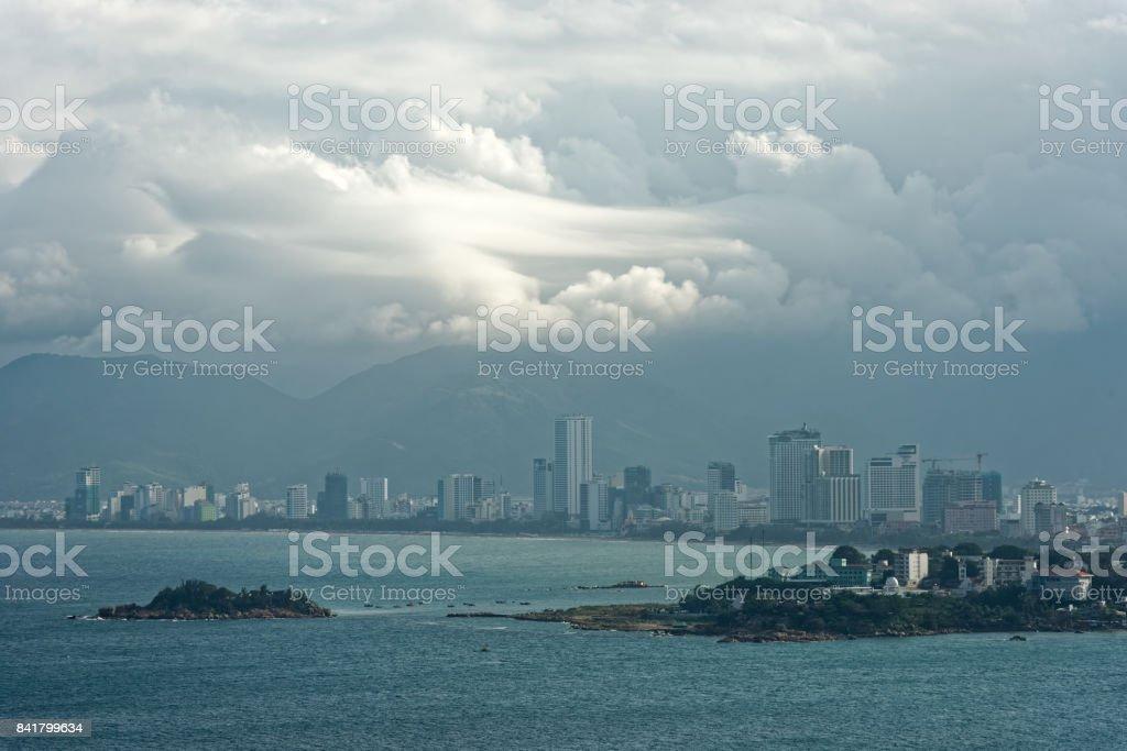 coast city NhaTrang at sunset, Vietnam. stock photo