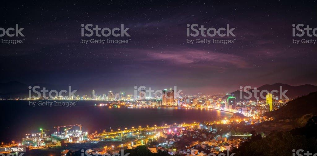 Coast city NhaTrang in night time, Vietnam. stock photo