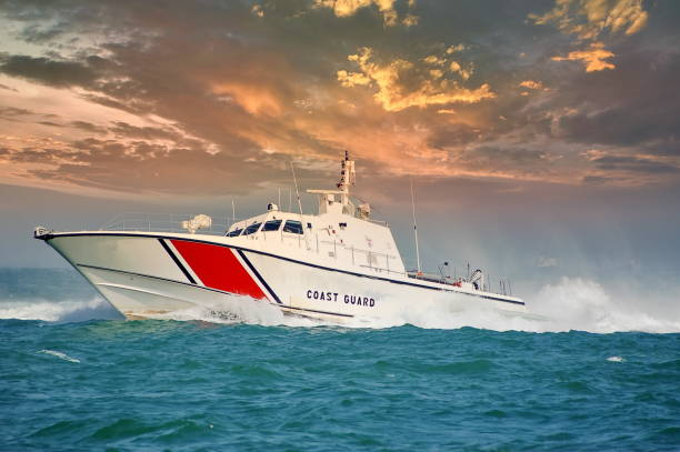 coast guard boat and cloudy sky stock photo
