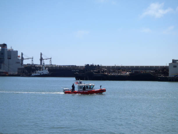 US Coast Guard Boat drive through the water in McCovey Cove San Francisco - August 20, 2010:  US Coast Guard Boat drive through the water in McCovey Cove. aegis stock pictures, royalty-free photos & images