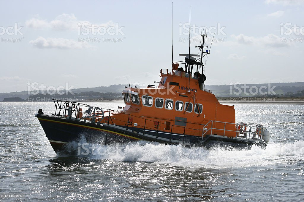 Coast guard boat moving quickly through the sea stock photo