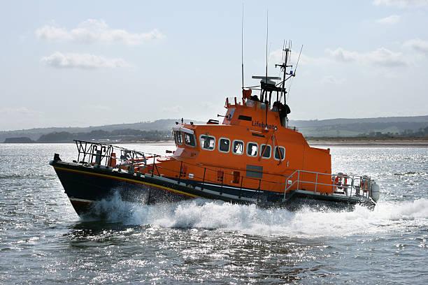 coast guard boat moving quickly through the sea - livbåt bildbanksfoton och bilder