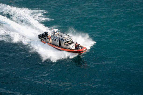 Coast Guard boat patrols Port Everglades, Florida stock photo