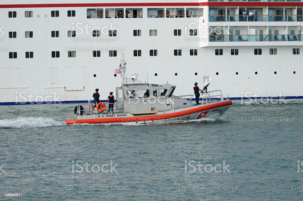 US Coast Guard escorts cruise ship royalty-free stock photo