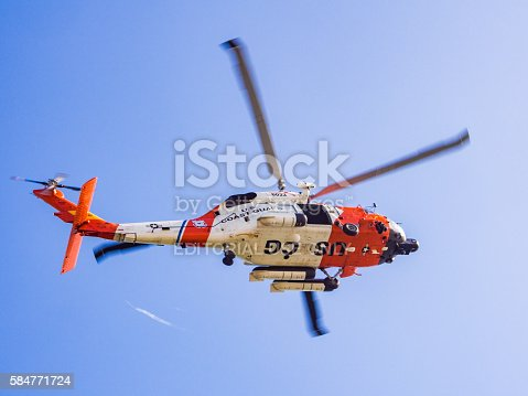 San Diego, USA - March 15, 2013: US Coast Guard helicopter flying over San Diego in California, USA.