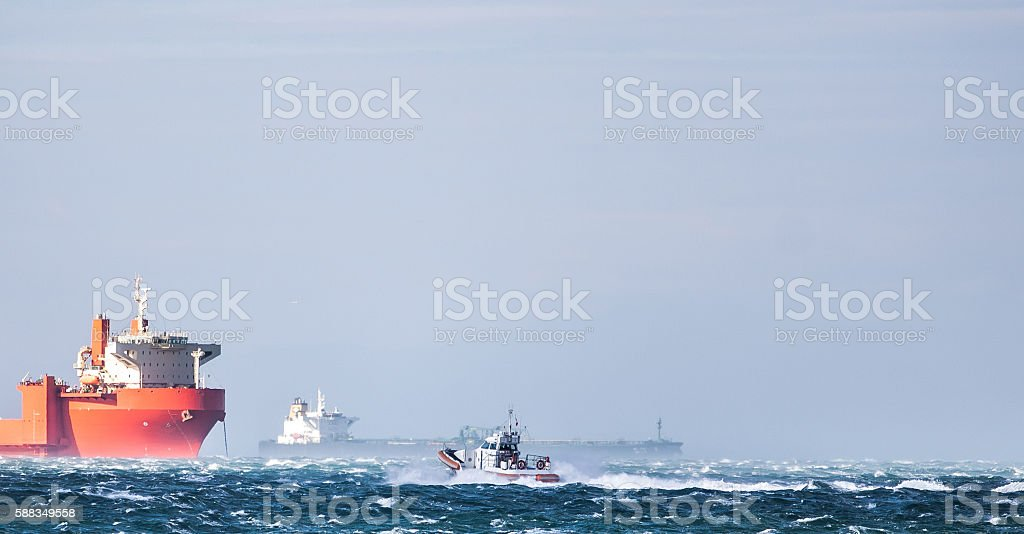 Coast Guard in storm and heavy wind . stock photo