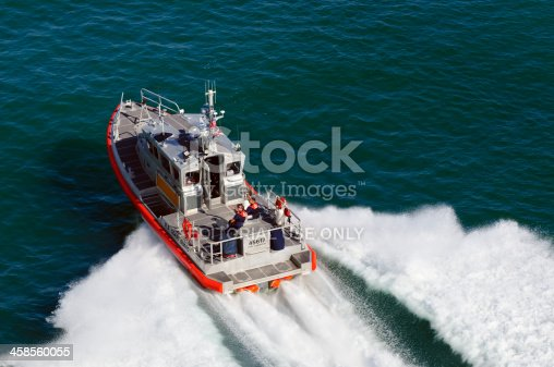 Port Canaveral, FL, USA - March 19, 2011: A U.S. Coast Guard response boat-medium (RB-M) vessel on the Florida coast. Forty-five feet (13.7 m) in length with a top speed of 42 knots (78 km/h), it has the capacity to tow a 100-ton vessel in eight-foot seas.
