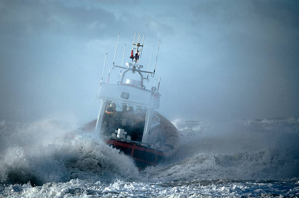 Coast Guard ship during storm in ocean stock photo