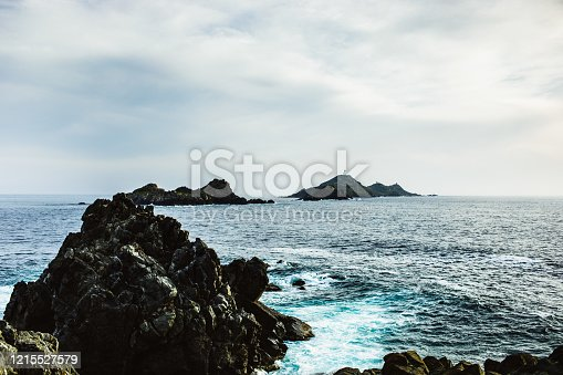 Coast of Ajaccio Corsica iles Sanguinaires rocks in the foreground rocky islands in the background