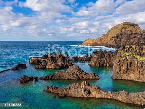 Natural swimming pools on volcanic region of Porto Moniz on the coast of Madeira island, Portugal