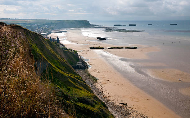 coast of Normandy remains of artificial Mulberry Harbour at Arromanches, France normandy stock pictures, royalty-free photos & images