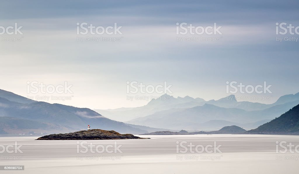 Coast of Norway sea. Clouds of haze. Beacon on rock stock photo