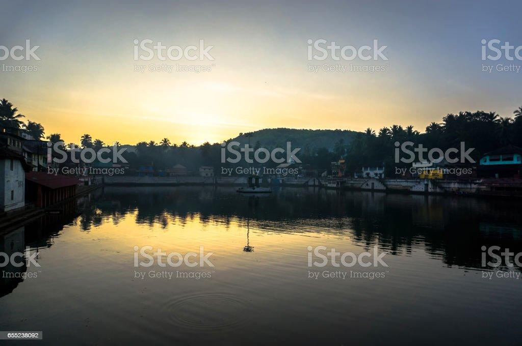 KARNATAKA, Coast of sacred lake in Gokarna during sunset stock photo