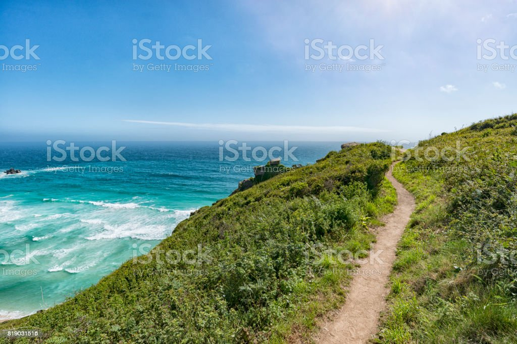 Coast path leading to Pedn Vounder Beach, South Cornwall. stock photo
