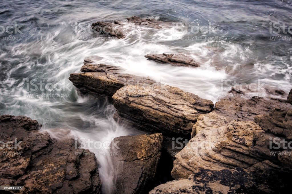 Coast with rocks and water stock photo