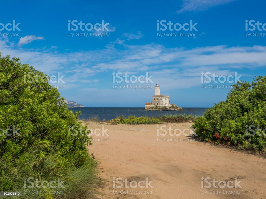coastal area with view on island with lighthouse stock photo