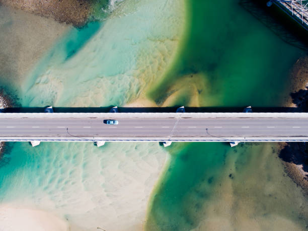 Coastal Bridge Aerial photograph of a coastal bridge in Tasmania, Australia oceania stock pictures, royalty-free photos & images