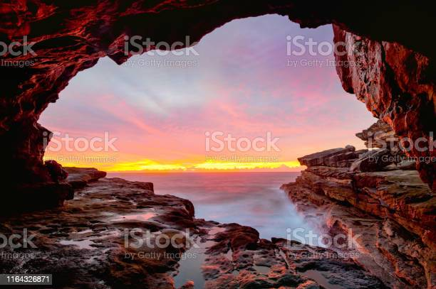 Photo of Coastal cave views to glorious sunrise over the ocean