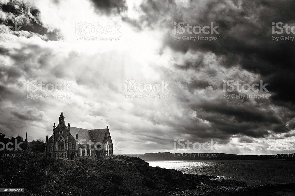 Coastal Church under dramatic sky black and white stock photo