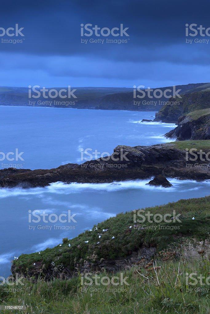 coastal cliffs along the Cornish coast at dusk royalty-free stock photo